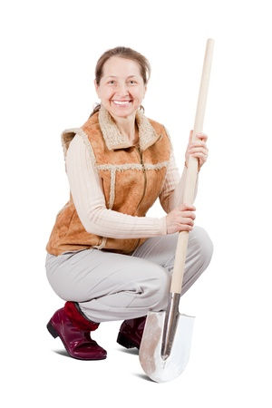 pastoral: Happy pastoral  woman sits with spade over white