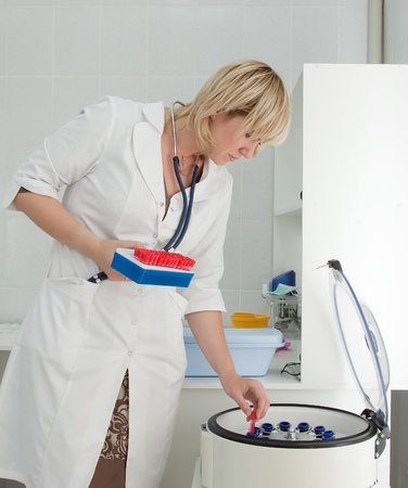 centrifuge: Doctor working with electronic blood centrifuge in medical clinic