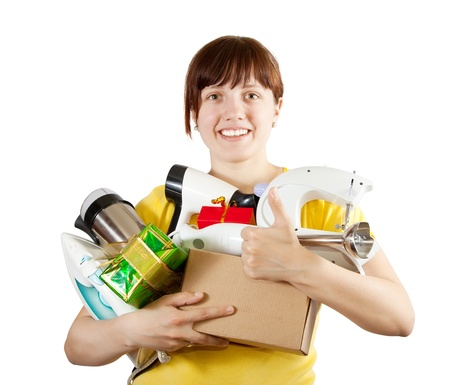 sewing box: young woman with heavy-handed of household appliances over white