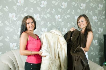 Women  make boast of fur coats  in home Stock Photo - 10131901