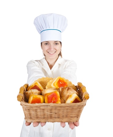 Portrait of female cook with cookies over white photo