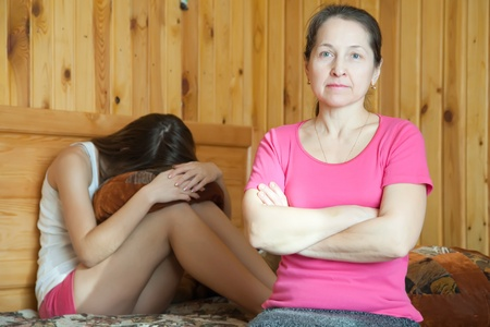 only teenage girls: Mother and teen daughter having quarrel at home