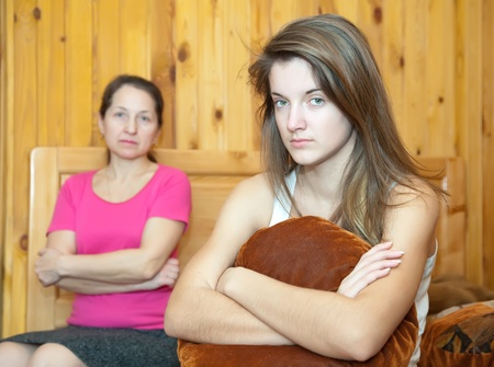 teenr daughter and mother having quarrel at home Stock Photo - 10131944