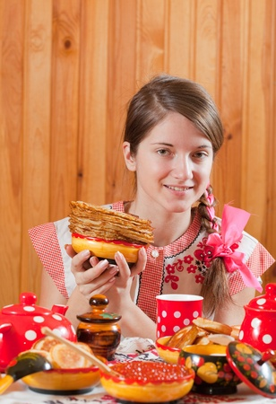 sudarium: Girl in traditional  clothes with pancake during  Pancake Week