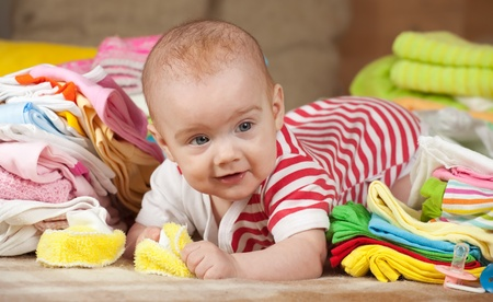 babygro: baby girl with heap of childrens wear
