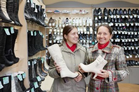 Two women shopping at fashion shoes shop photo
