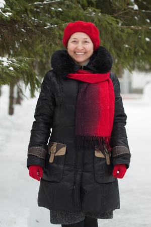 smiling mature woman is walking at winter park Stock Photo - 10191799