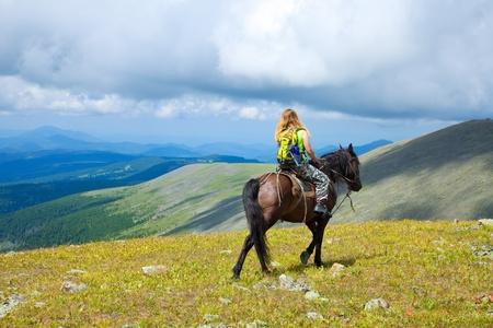 horseback: Female rider on horseback at mountains
