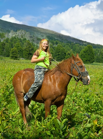 girl riding a horse bareback at mountains  photo