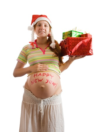 Pregnant woman with christmas gifts over white photo