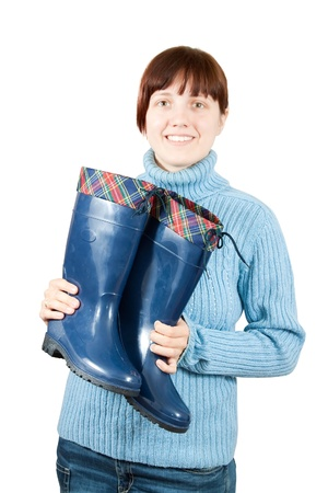 gumboots: Woman holding waterproof gumboots. Isolated on  white background