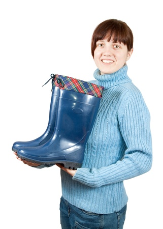 Woman holding waterproof wellington boots. Isolated on  white background  photo