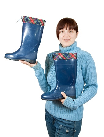 welly: Woman holding waterproof wellington boots. Isolated on  white background  Stock Photo