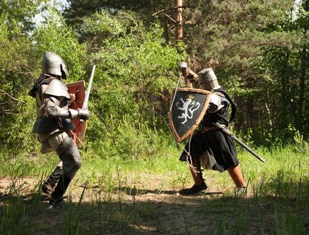 crusades: Two knights in armor is fighting  at forest Stock Photo