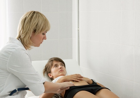 Woman doctor examining the patient in clinic Stock Photo - 10322923