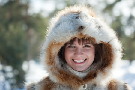 Portrait of smiling girl in fur coat at wintry park Stock Photo - 10333825