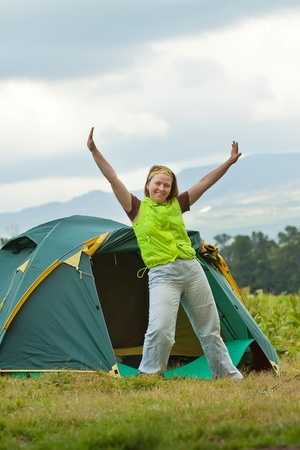 Camping happy woman stretching outdoors photo