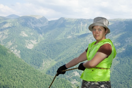 alpinism: Climber belay partner on top forest mountains