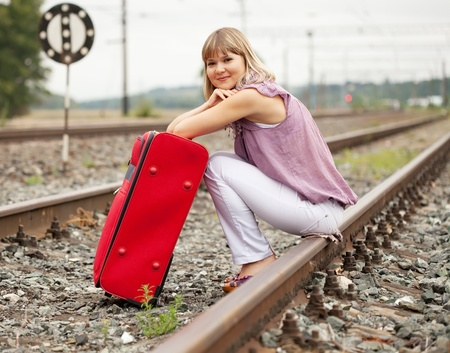 woman with luggage sitting on rail Stock Photo - 10333837