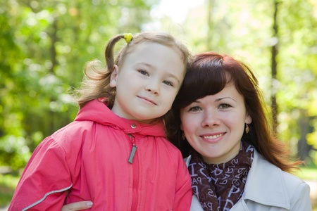 Happy mother with little girl outdoor in autumn Stock Photo - 10333834