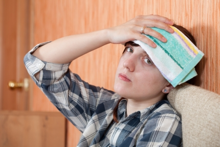 woman having  headache holding towel on her head Stock Photo - 10352351