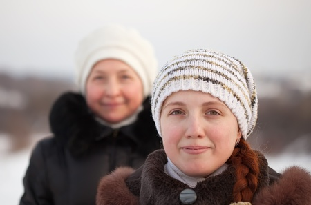 douther: Portrait of two women in winter park