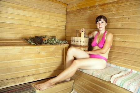 Young woman  sitting on wooden bench  at sauna Stock Photo - 10371361