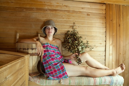 swelter: Young woman taking steam at sauna