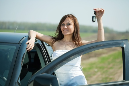 age 30 35 years: Mid adult woman holding keys to new car