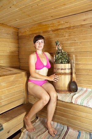 Young woman  sitting on wooden bench  at sauna Stock Photo - 10397810