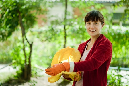 Female gardener fertilizes the soil in garden Stock Photo - 10397799