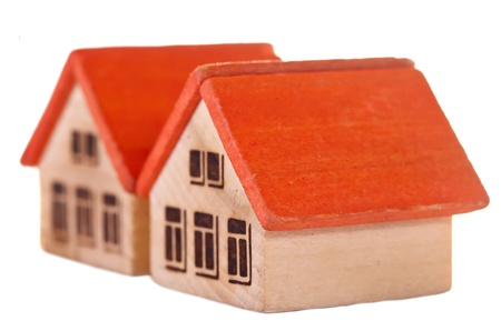 Two  wooden  toy houses on white background photo