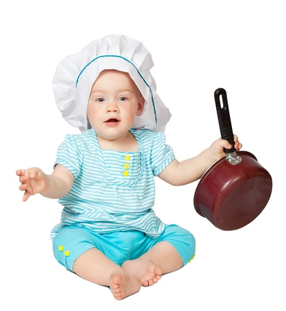 Baby cook in toque over white background photo