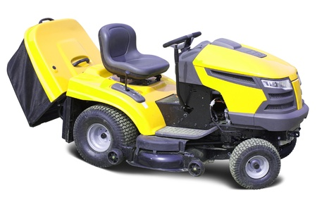 Yellow lawn mower. Isolated over white background photo