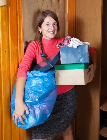Girl tossing out the garbage at home photo