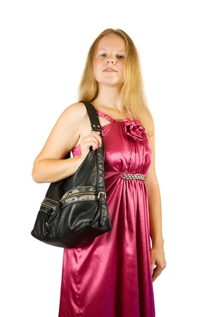 girl in purple dress with purse. Isolated over white with clipping path