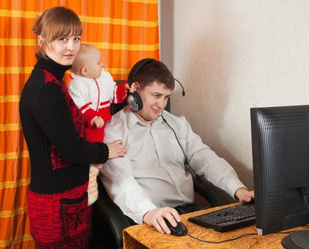 miscommunication: Man works at home. Iincomprehension  between man and his wife with daughter