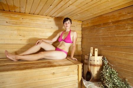 washhouse: Young woman  taking steam-bath  at sauna