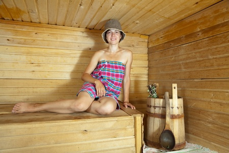 stive:  Young woman is sitting in  sauna