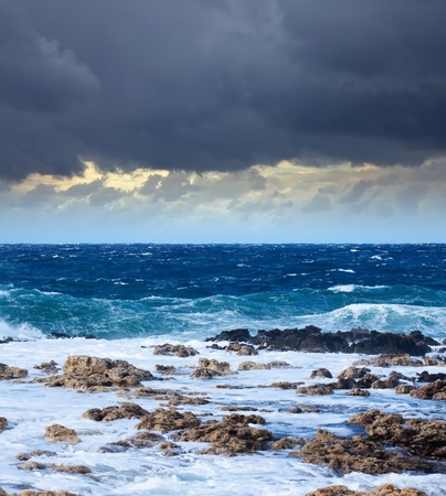 Sea wave breaking against coast  rock. Mediterranean area photo
