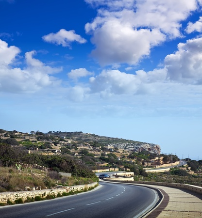 asphalt road through mediterranean cliffs. Maltese islands photo