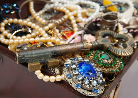valuables: Background of closeup of Treasure chest with valuables  and key