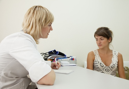 Woman doctor and patient in clinic Stock Photo - 10533559