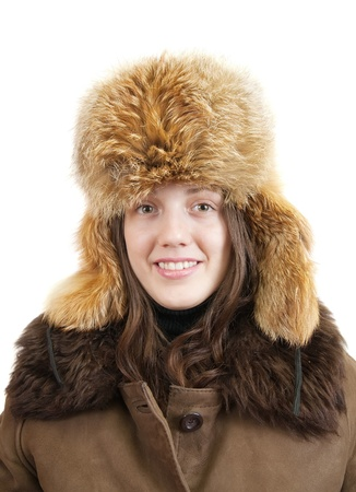furskin: young woman in sheepskin coat and fox cap on white background Stock Photo