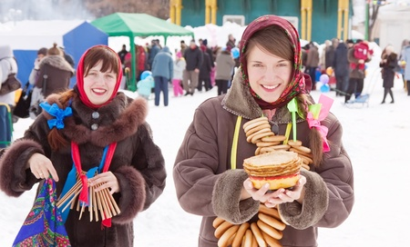 Two happy girls celebrating  Shrovetide  at Russia Stock Photo - 10533628