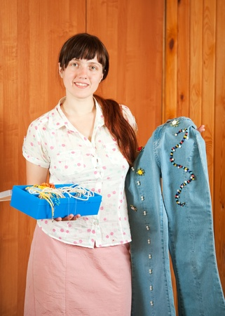 Woman shows a handmade cloth beaded by herself Stock Photo - 10606356