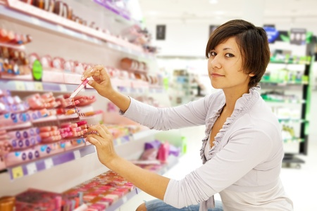 girl buying cosmetic at cosmetics  shop photo