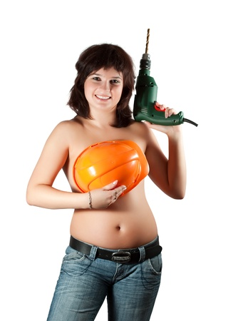 Topless woman with  hardhat and drill over white Stock Photo - 10612586
