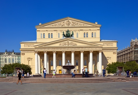 bove: MOSCOW, RUSSIA - AUGUST 29: People before  Grand Theatre in August 29, 2011 in Moscow, Russia. Grand Theatre (Bolshoi Theater) is one of the most famous theaters in the world Editorial