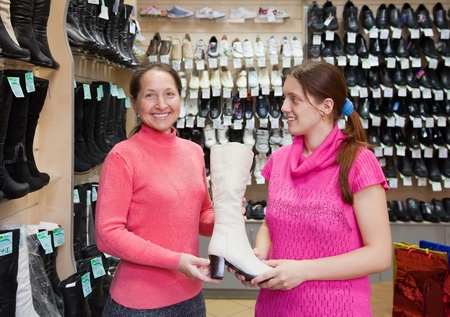 Two women chooses high shoe at shoes shop Stock Photo - 10643000